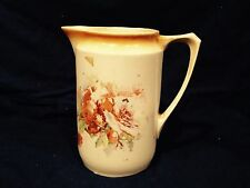 White and Tan Pitcher Porcelain With Painted Flowers