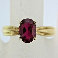 LADIES 10K YELLOW GOLD SOLITAIRE SYNTHETIC RUBY RING; 1.7G
