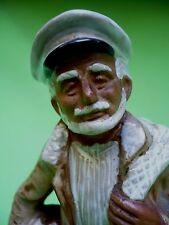 Vintage Terra Cotta Fisherman w/net & his catch statue figurine.Glaze & unglazed