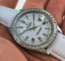 LADIES ROLEX 15200 WITH CREATED DIAMOND BEZEL. WHITE DIAL WITH ROMAN NUMERALS.