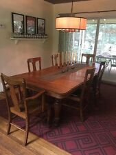Antique oak dining room table and chairs. 1 captain chair and 5 armless. 3 leaf