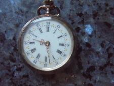 belle petite montre a gousset a remontoir en argent 2ton