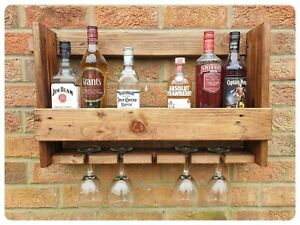 Rustic wall mounted reclaimed wood champagne gin rack and glass holder