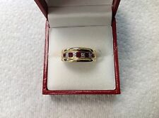 14k yellow gold band ring with rubies and diamonds