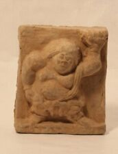 Chinese Song Dynasty molded tomb tile of a dwarf