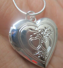 Sterling Silver Heart Shape Locket with 2 Hearts and Leaves
