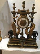 FINE CARVED EBONY AND GILT-WOOD EGYPTIAN REVIVAL MANTEL CLOCK WITH FIGURES