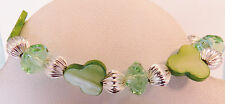 NWOT Green Stretchy Bracelet with Clover Shaped Mother of Pearl, Faceted Green