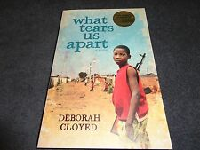WHAT TEARS US APART  BY  DEBORAH CLOYED (LARGE PAPERBACK BOOK)