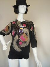 FACTORY OUTLETS  JUMPER SEQUINS AND FLOWERS  SIZE 16 TO 18 STRETCHY