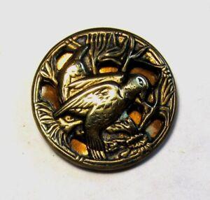 Medium Antique Openwork Brass Button Bird Tinted Shiny Background