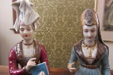 Two fine china figurines with the mark A on the bottom