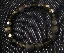Very pretty dark tone beaded and elasticated bracelet with faceted beads