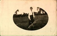 Portrait lady & dog in hay field RPPC postcard real photograph antique farmers