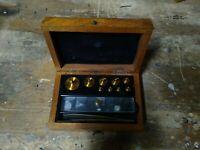 8 Vintage Antique Brass Balance Scale Weights with Original Wooden Box.