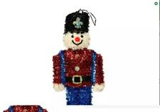 Christmas Themed Tinsel Nutcracker Wall Decor, 15x6.75 in red blue