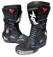 SANDRO CORTESE RACE WORN AND SIGNED MOTOGP BOOTS - AUTOGRAPH - 125CC 2011.