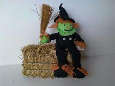 halloween scarecrow on bale of hay decoration