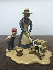 Roman 1993 Americana Collection Artist Bill Jauquet Mother and son feeding calf