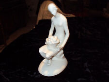 ITALY  PORCELAIN  STATUE   LADY  HOLDING  FRUI T BASKET 7''  TALL NO CHIPS