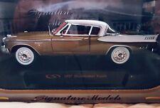 Signature Model 1957 Studebaker Golden Hawk Die-cast Car Gold And White 1:32