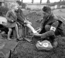 WWII B&W Photo Canadian Medic Treats Injured French Child  WW2 France  / 1246