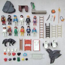 Lot de pièces Playmobil en vrac :  personnages, échelles, accessoires divers...