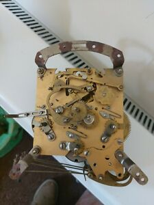 AN EIGHT DAY  CLOCK MOVEMENT FOR SPARES OR REPAIR