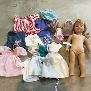 American Girl Doll with clothes lot