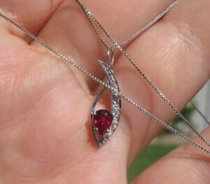 $1750 Untreated Pigeon Blood Ruby F/VS diamonds white gold pendant on a chain.