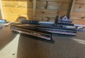 Oo gauge Mark 4 swallow with lights and passengers