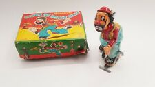 Tin Toy TPS Wind up SKATING Clown with original box