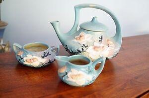 """Vintage Roseville """"Magnolia"""" Tea pot , creamer and sugar set."""