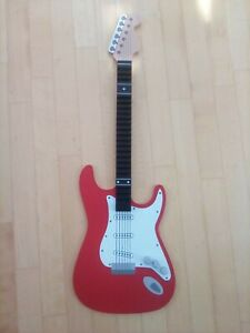 Wall mounted CD storage, guitar shape - used, in very good condition. 90 cm tall