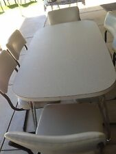 RETRO DINNING TABLE FROM EARLY 60s CHAIRS ARE FROM THE 90s