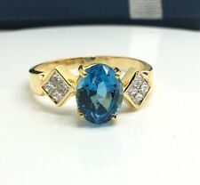 18k Yellow Gold Blue Topaz And Diamond Ring. November Birthstone