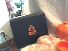 Teavana teapot set. 4 cups, tea pot with strainer.  New in box.  Orange pot is 5