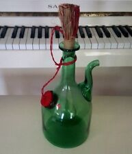GREEN BOTTLE WITH STRAW TOPPER AN ICE CHAMBER AND RED COVER MADE IN ITALY