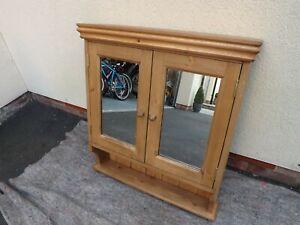 Pine 2 door mirror bathroom cabinet made by our own carpenter. 65 cm width.
