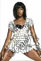 A 12 x 8 inch photo featuring Alexandra Burke, personally signed by her.