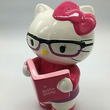 """Hello Kitty Ceramic Coin Bank Holding Book. Wearing Reading Glasses. 9"""" TALL."""