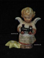 +# A010619_54 Goebel Archiv Muster Engel mit Kerzenhalter und Lok HX235