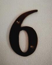 Black metal door number 6