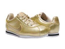 Nike 859570-900, Zapatillas de Deporte para Niñas, Dorado (Mtlc Gold Star/Mtlc Gold Star), 34 EU