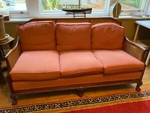 Bergere 3 seater sofa. Fabric terracotta damask. Caning in good condition.