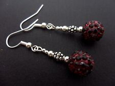 A PAIR OF DANGLY DARK RED SHAMBALLA STYLE EARRINGS. NEW.