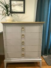 Gray dresser with gold accents