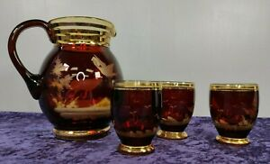 Bohemian Ruby Red hand engraved glass, water jug and 3 glasses