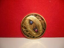24k gold lord of the rings $1 coin made with red and blue Swarovski Crystals.