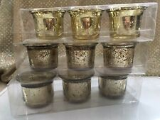 Three Pack of three glass votive holders ( Total of 9 )